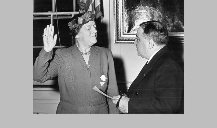 Mayor Fiorello La Guardia swears in Genevieve Earle, the City Council member from Brooklyn, December 1945