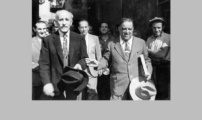 The U.N. Relief and Rehabilitation director-general, La Guardia, with Arturo Toscanini, the orchestra conductor, in Milan, Italy, 1946