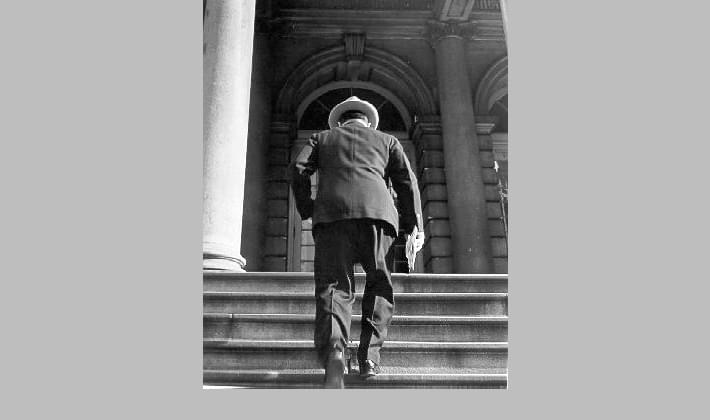 Candid picture of Mayor La Guardia entering City Hall