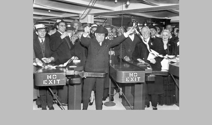 Mayor Fiorello La Guardia cuts the tape at the opening of the new 6th Avenue subway at West 34th Street, December 1940. The subway cost a nickel