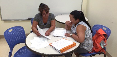 Staff Tutoring Students at the Writing Center