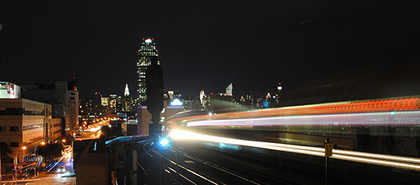 Energy Technician: shot of LaGuardia at night with the 7 train passing by