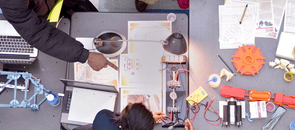 Overhead shot of Engineering student building a product