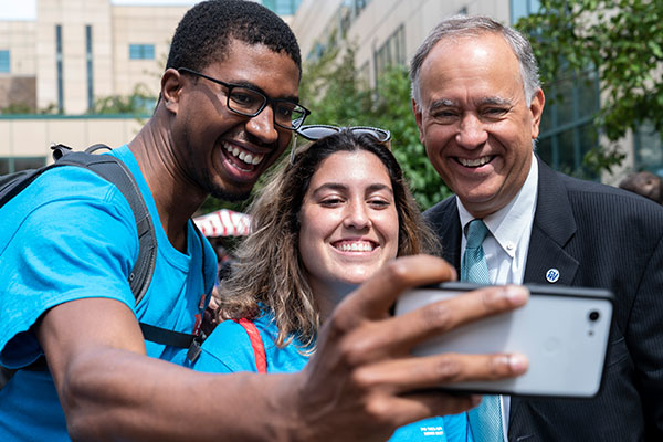 Chancellor Matos Rodriguez smiling with students